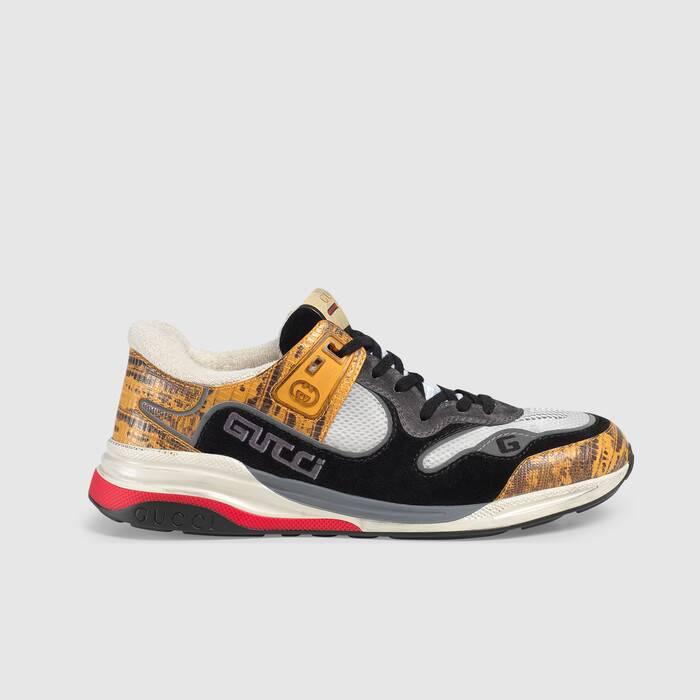 这款男士运动鞋灵感源自经典跑步鞋,采用多种皮革和织物拼接而成。作为 2019 秋冬系列全新推出的款式,这款运动鞋巧妙融合了蜥蜴纹皮革、麂皮、反光织物和网眼布滚边。丰富的品牌设计元素为运动风造型锦上添花,包括刺绣 Gucci 和 G 字样、橡胶互扣式 G 细节和 Gucci 复古标识标签