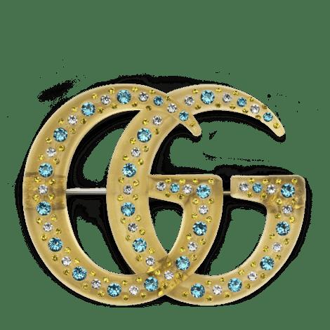 饰水晶树脂双G胸针