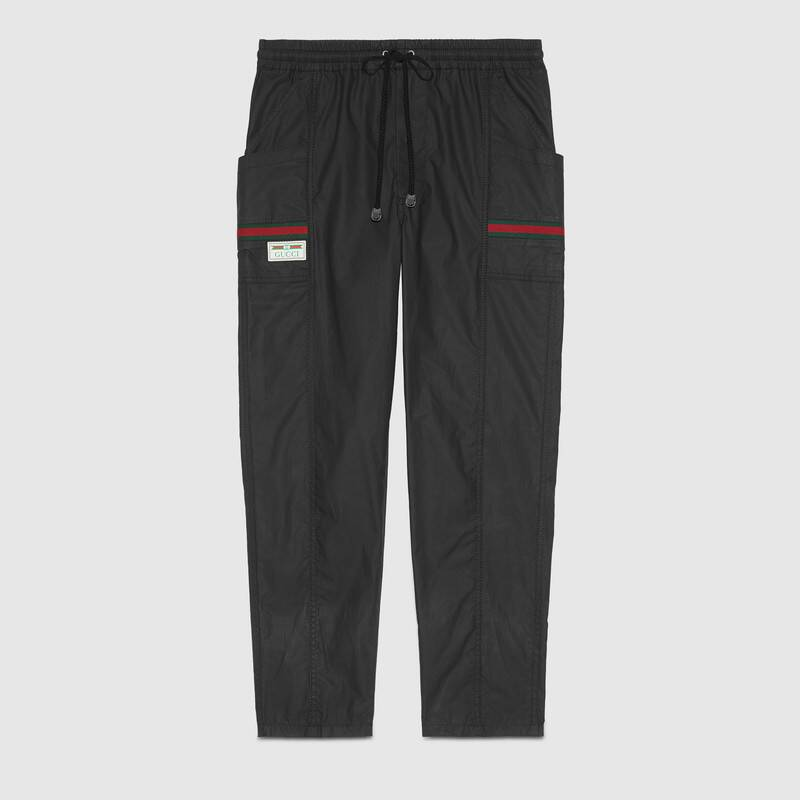 Gucci Coated Cotton Trousers With  Label In Black