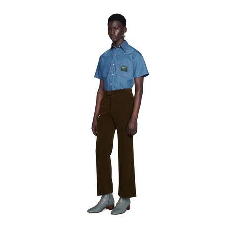 饰Gucci Boutique标签牛仔衬衫